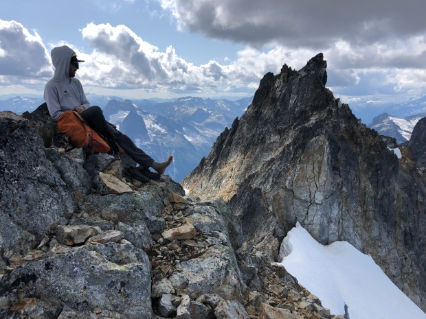 Tim atop Pyramid Peak with Degenhardt in the background in the southern Picket Range.